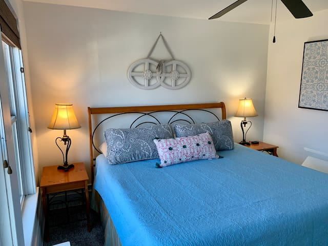 Cozy King Size Bed with comfy linens and pillows
