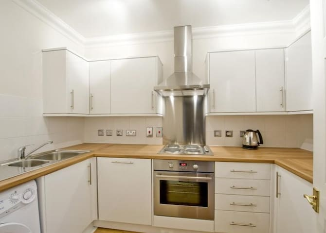 Kitchen done to a high standard with washing machine/dryer