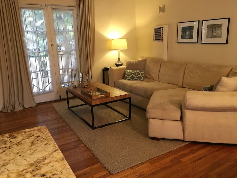 Living room has large french doors with lots of light.