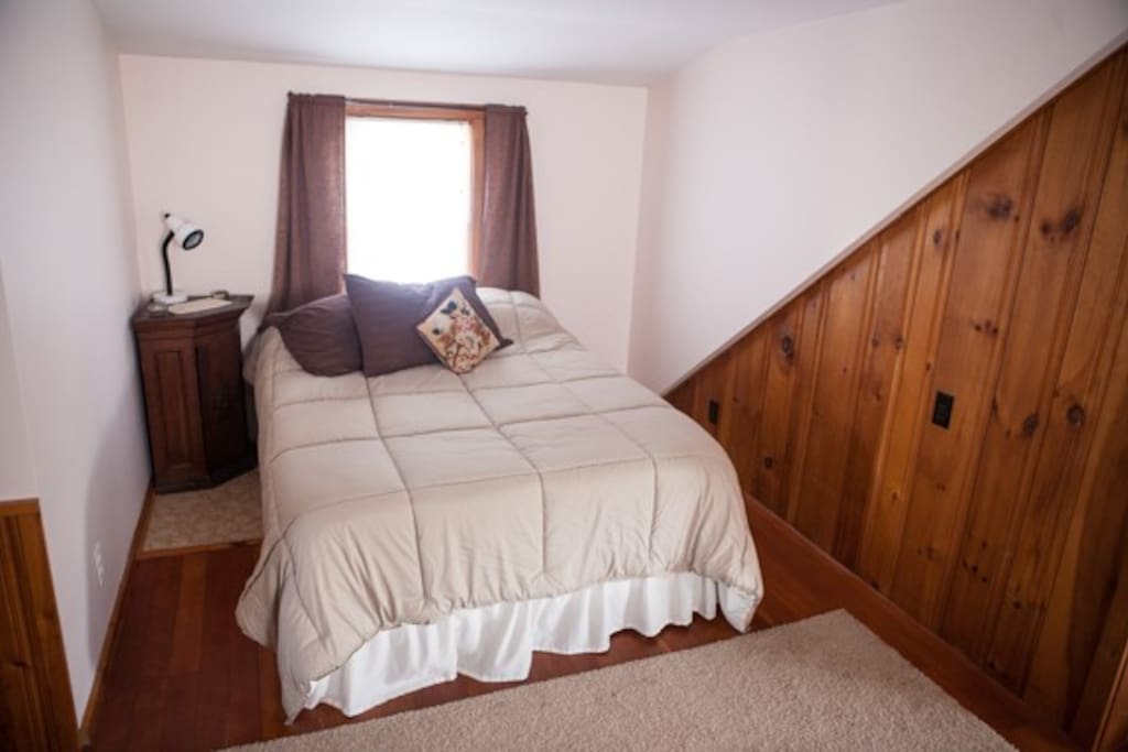The room offers this comfortable double bed, cool in the summer and warm in the winter.