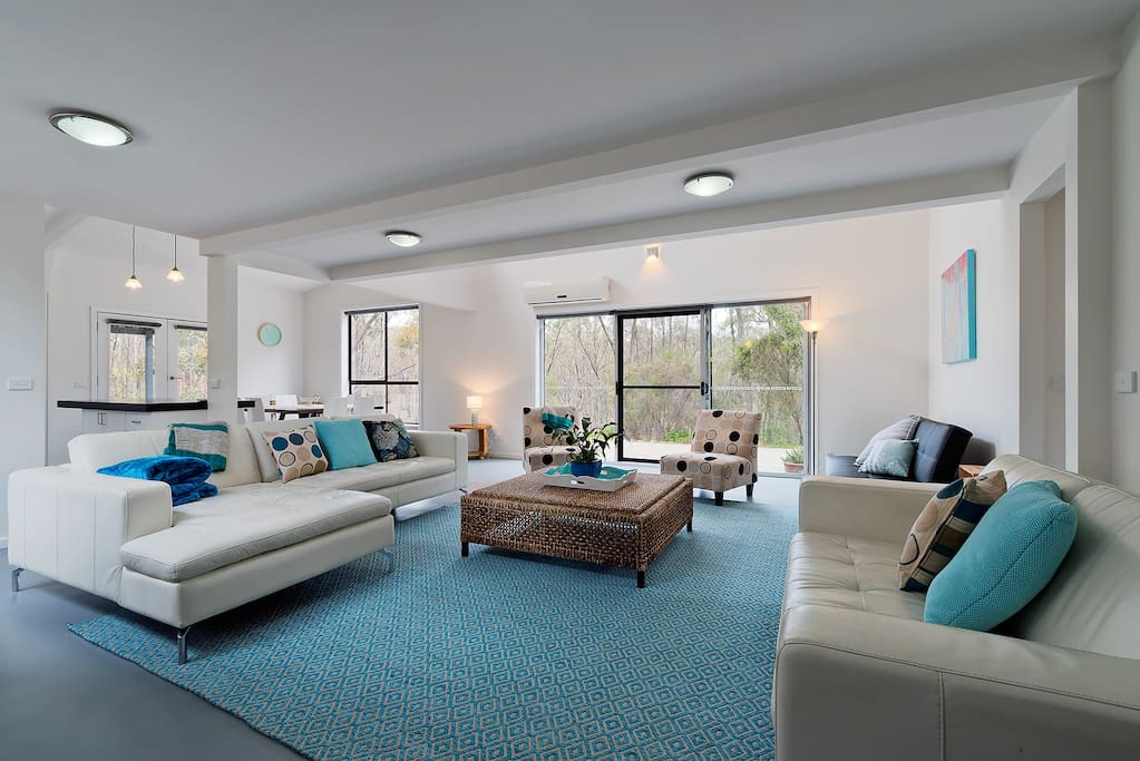 light filled, spacious and stylishly decorated open plan living area with views of nothing but trees from every window!