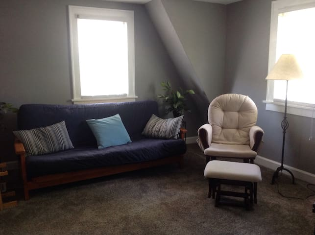 Futon and sitting chair in the living room