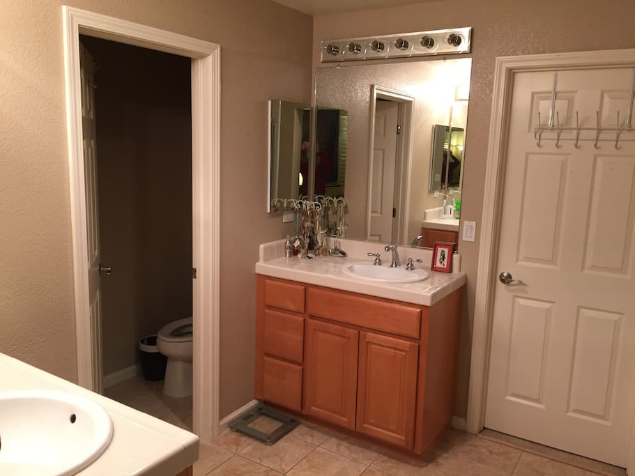 Two sinks and private toilet room