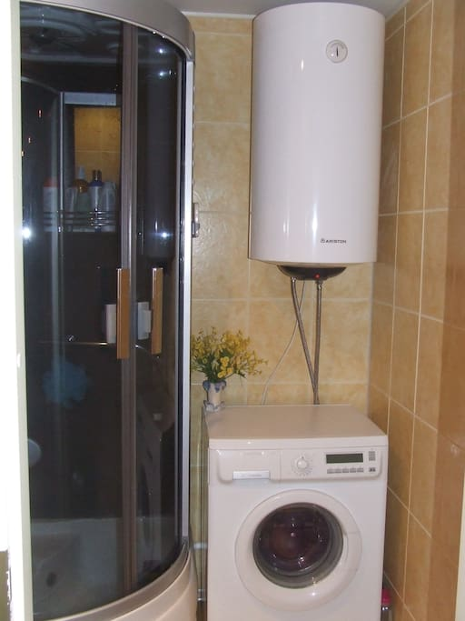 Shower and a washing machine.