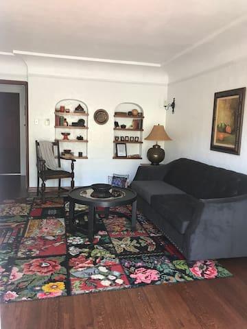Living Room has Queen Sofa Sleeper