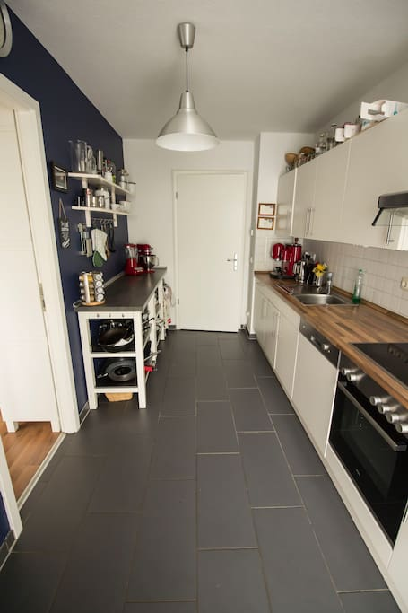 Kitchen with dish washer, oven and appliances like microwave