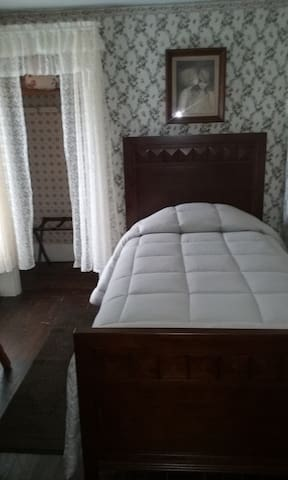 Air Condioning in summertime. Twin bed with TV, Radio Clock and Fan.