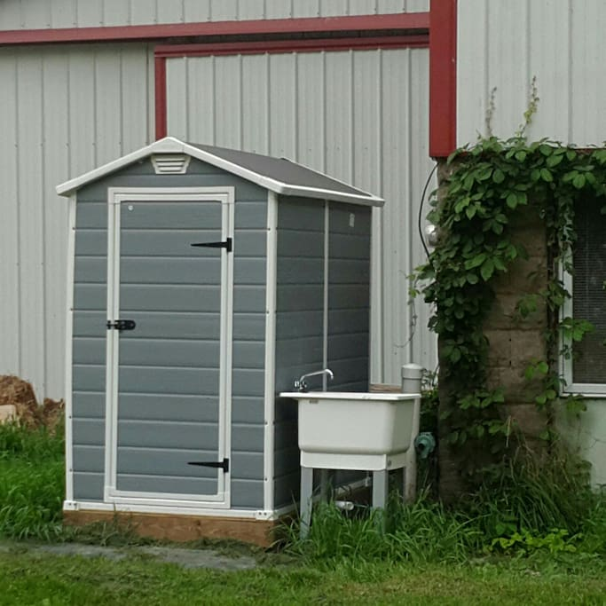 Outdoor flushing toliet and outdoor hand wash station.