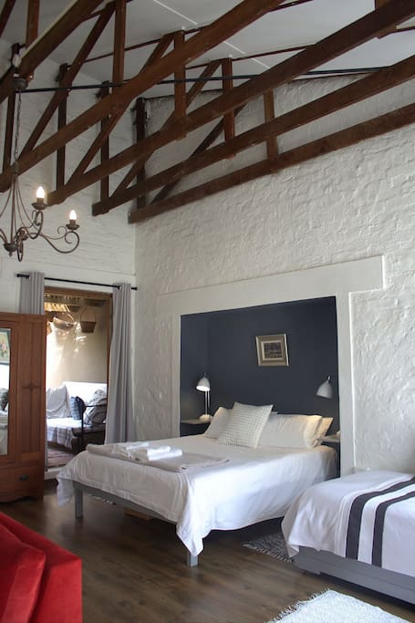 The high ceiling and exposed roof beams add character to the room. A view into the private ,covered verandah.