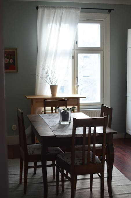 Spacious kitchen table for dining.