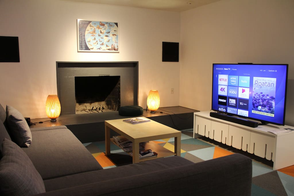 "Living room with fireplace. TV is a 55"" ultra HD (4K). No cable TV, but there's free Netflix, Amazon Prime, Blu Ray player, Wii game console, and an HDMI cable so you can plug your laptop into the TV."