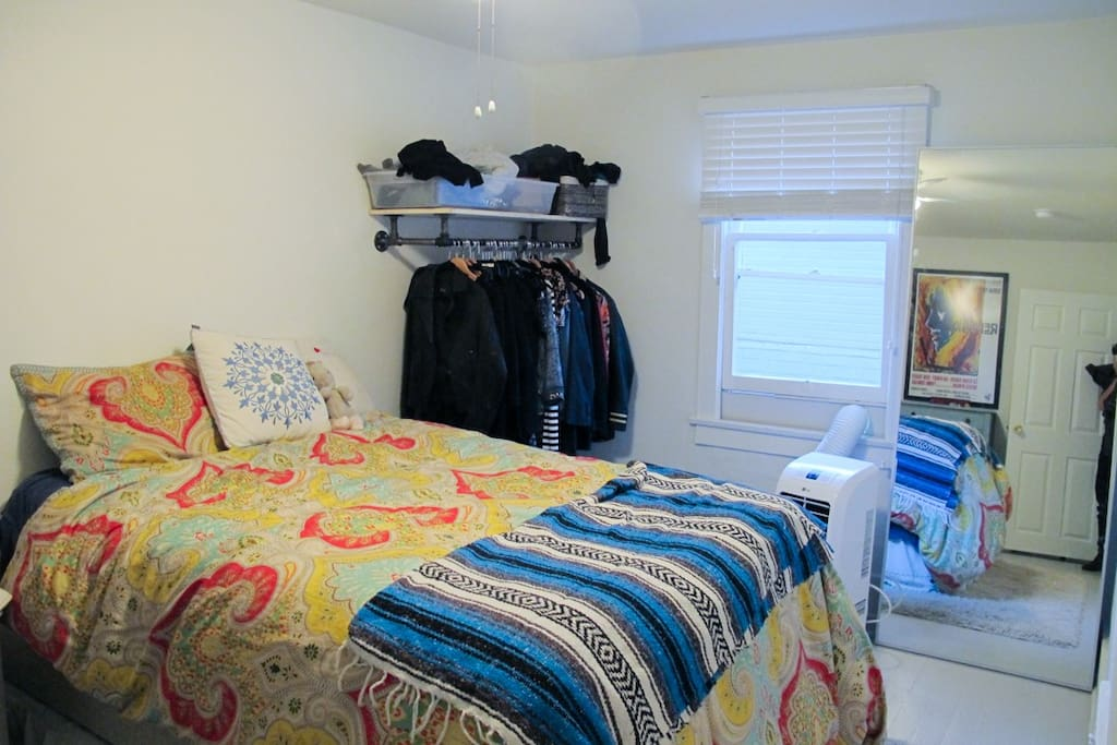 Bedroom. Full size bed. AC / Heater unit. Full length mirror. Small space for hanging clothes.