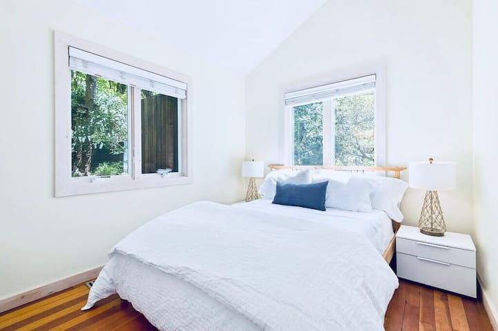 Bedroom 3: This light & airy bedroom has a queen size bed and smart TV.