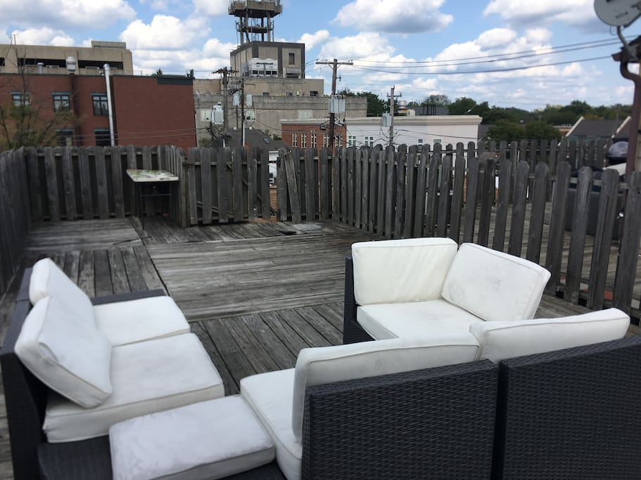 Rooftop deck with seating.