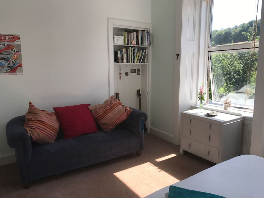 Comfortable double bedroom with king sized bed and settee. Over looking landscaped garden.