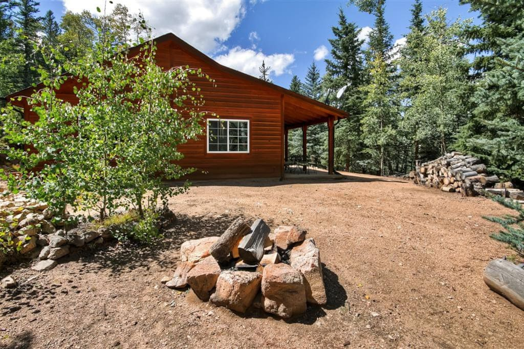 You'll simply fall in love with this cabin's wonderfully serene setting, tucked amidst thick woods