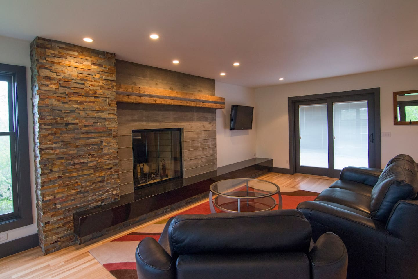 """Living room w/fireplace, recliner couches and 42"""" TV"""
