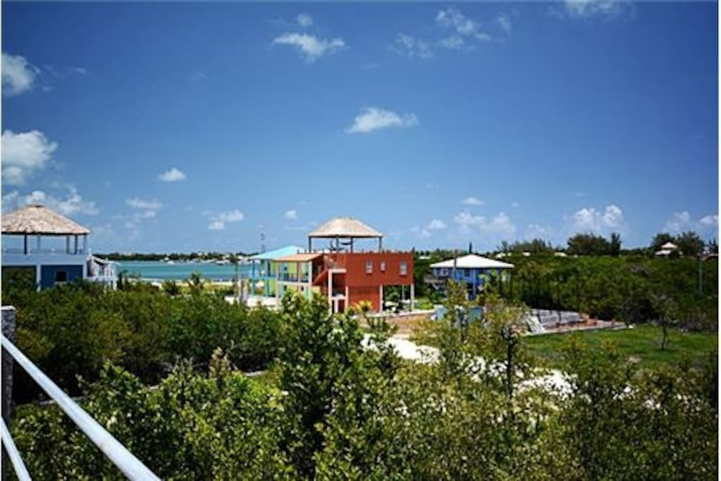 Quiet neighborhood of Caye Caulker, easy 10 minute bike ride from main village, amongst other vacation homes