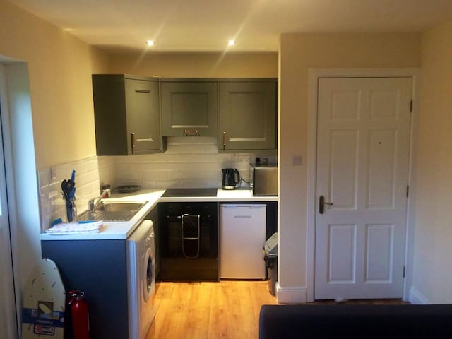 Fully equipped kitchen with oven, hob, washing machine and integrated dryer plus fridge and all utensils.