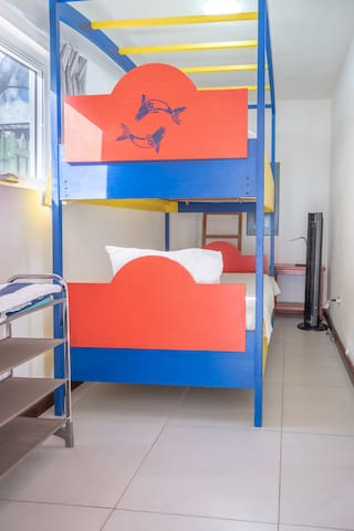 3rd Bedroom with bunkbed and floor fan.