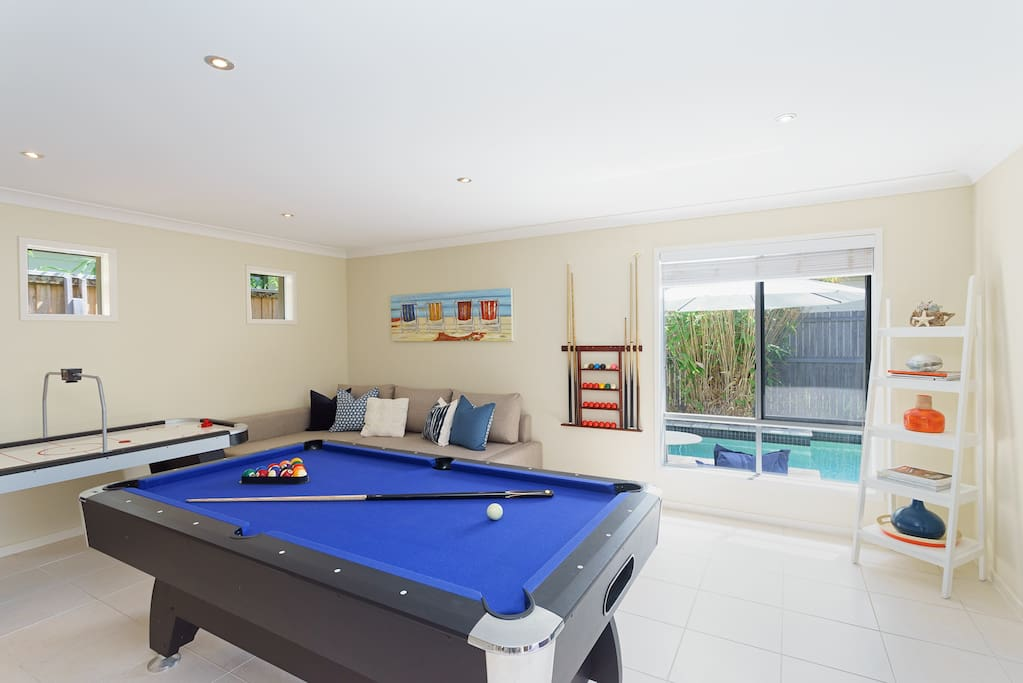 Games Room with a pool table & air hockey table