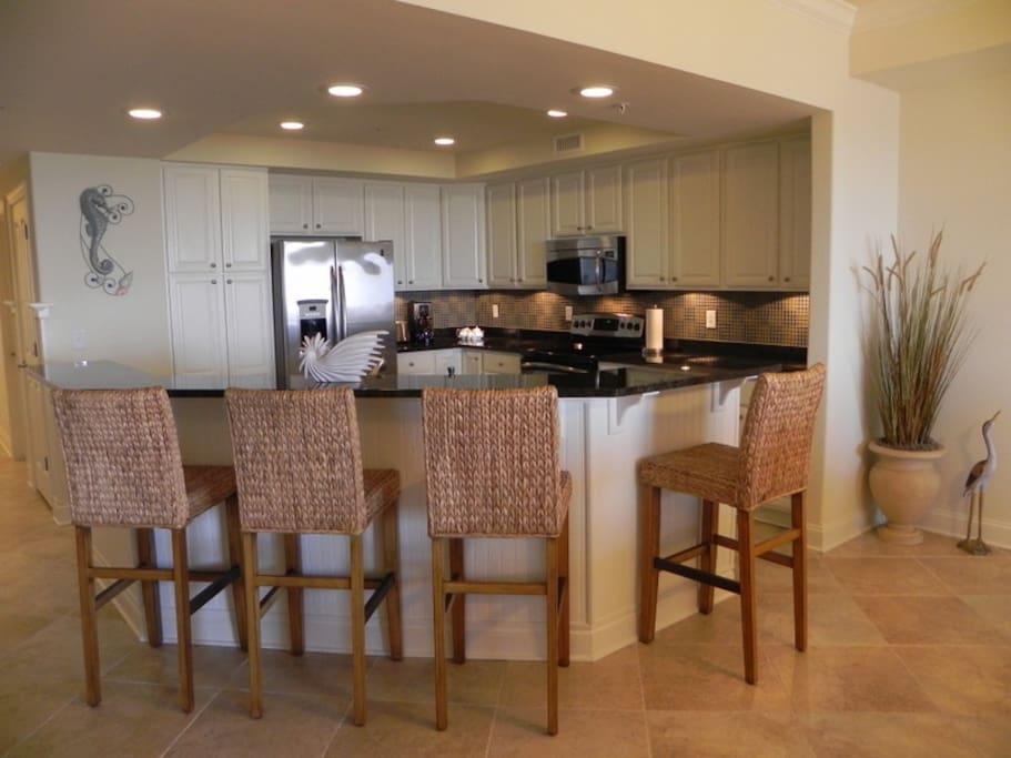 Gourmet Kitchen w/Wrap-Around Granite-top Breakfast Bar