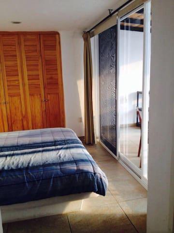 El Dormitorio.     The Bedroom.