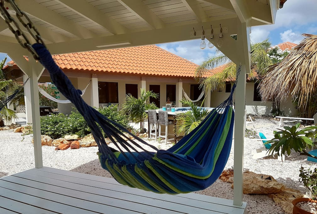 Opposite your apartment is a gazebo with 2 hammocks and beach chairs