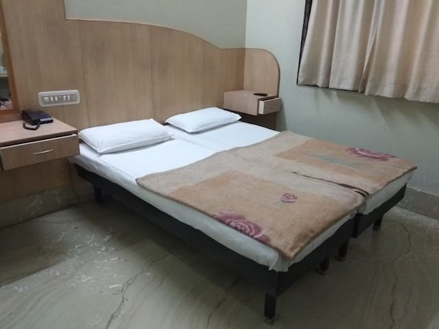 Budget Rooms at Cabbonpet Main Road, Bangalore
