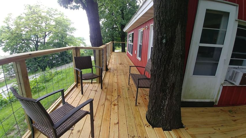 Brand new deck on the front of the cabin to sit and enjoy river views.