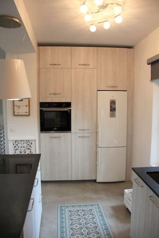 Kitchen cupboards with full-size fridge/freezer and fan oven