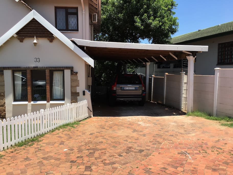 Shaded carport. Plenty of additional off-road parking. One garage space available.