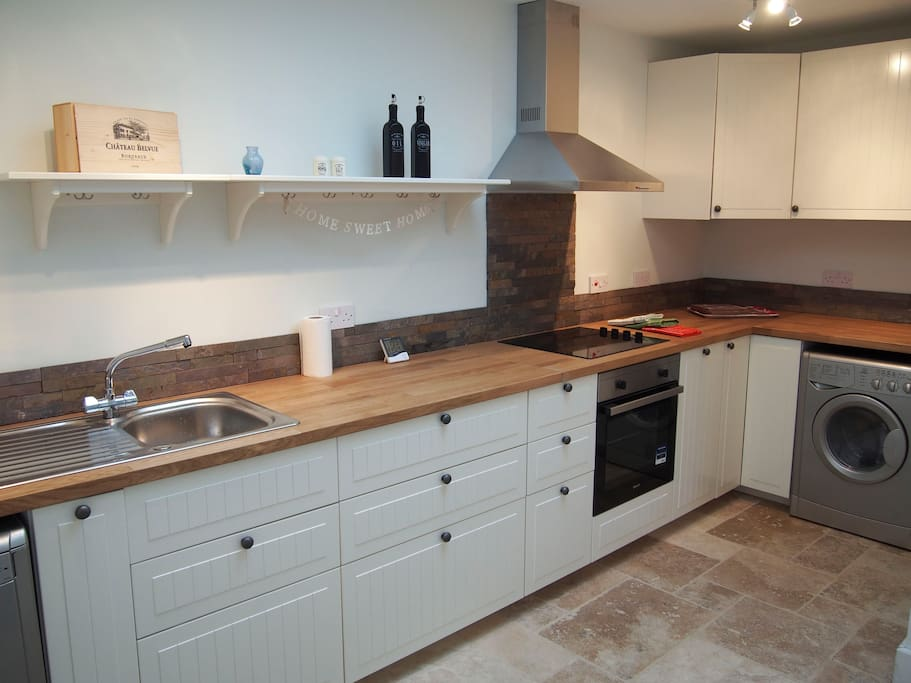 Open plan kitchen with dishwasher and usual stuff