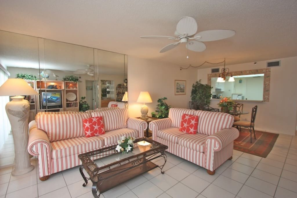 Open Living Room Area with Cable TV/Private Balcony with Gorgeous View of The Gulf