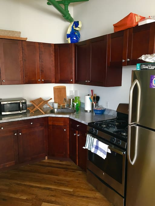 kitchen with fully stocked appliances