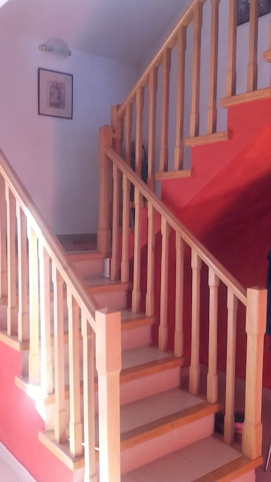 Stairway to first floor airbnb rental bedrooms, living-room, terrace and full bath.