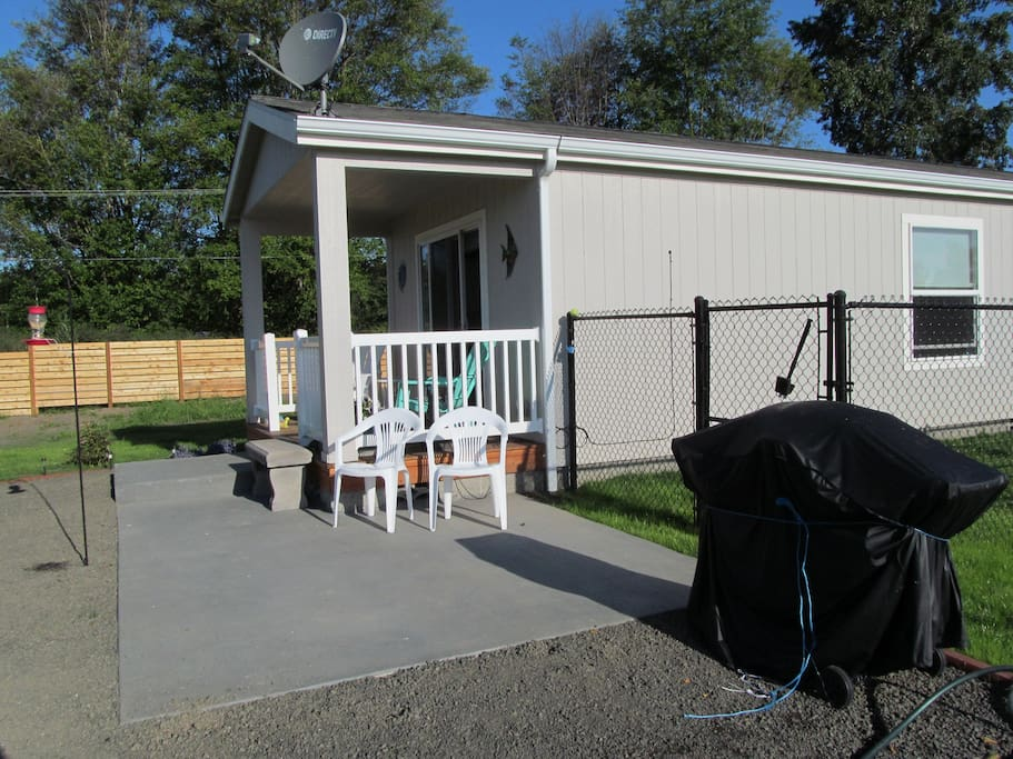 patio, porch, bbq-  also small backyard with grass, chain link.  Never leave your small dog out alone. Hawks/Eagles are abundant Wide open 6 acre field with view of Olympics.