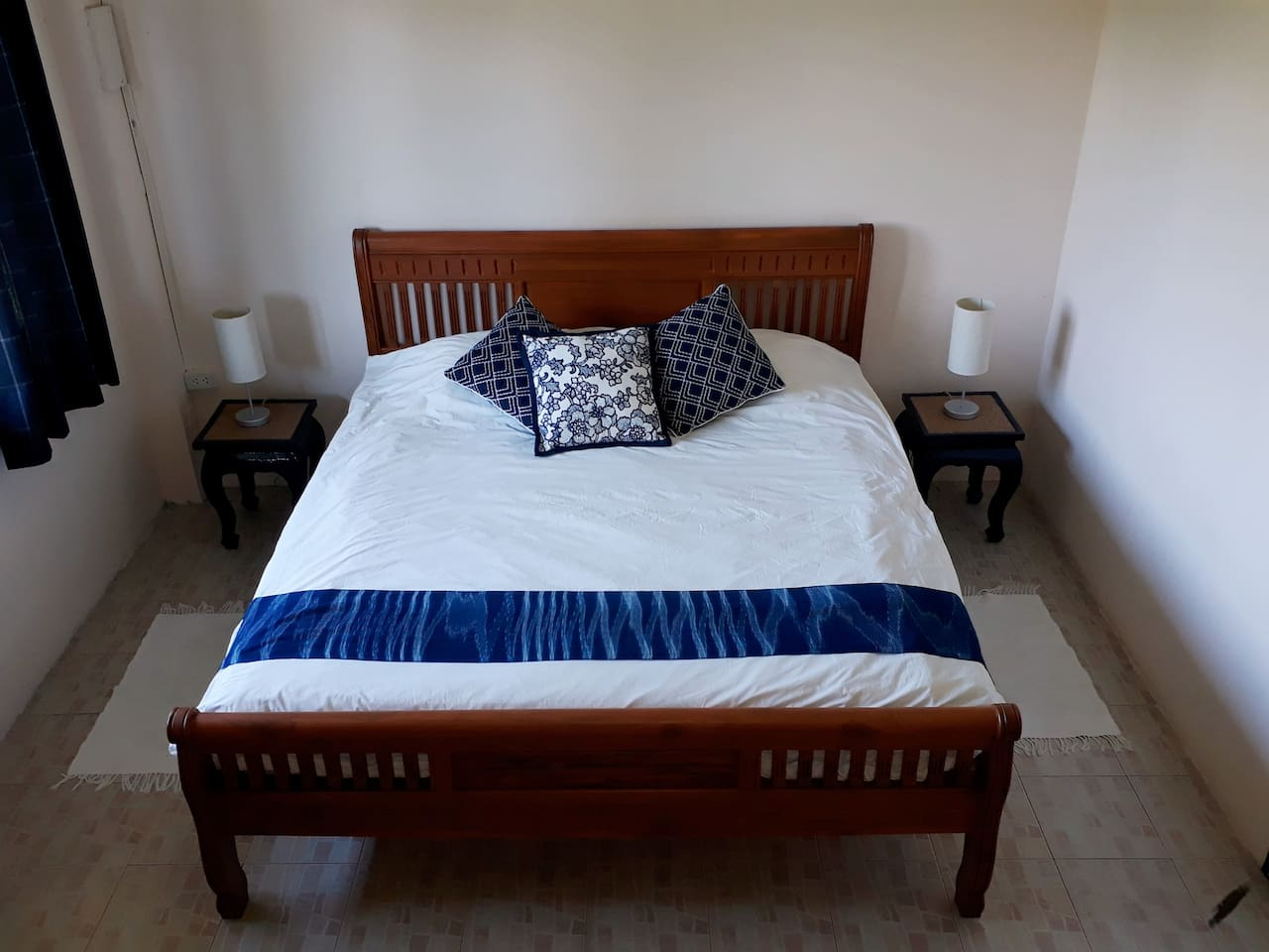 Our large bedroom with a king-size bed has a writing desk and cabinet for clothes too.