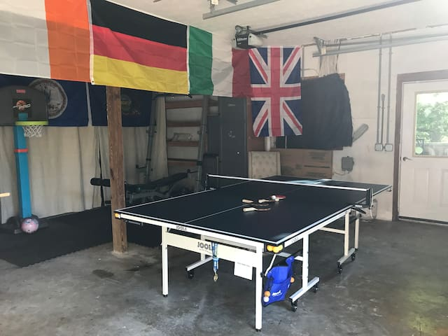 Fun Garage with Fooseball, Ping Pong, electric  dartboard and weightlifting supplies