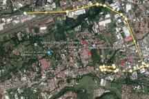 Esta vista aérea muestra la ruta más práctica para llegar al aeropuerto Internacional Juan Santamaría, ubicado a 8.6 km con un tiempo de traslado entre 20 y 40 min dependiendo de la hora.