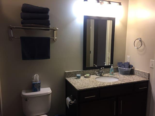 Attached private bathroom with granite countertop