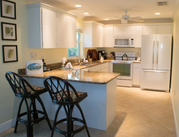Totally equipped kitchen with full size appliances.