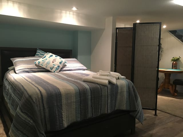 Alcove bedroom with queen bed