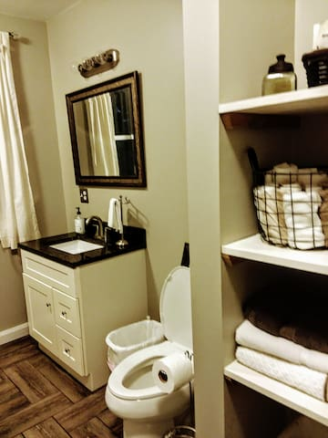 full bath with shower and washer/dryer