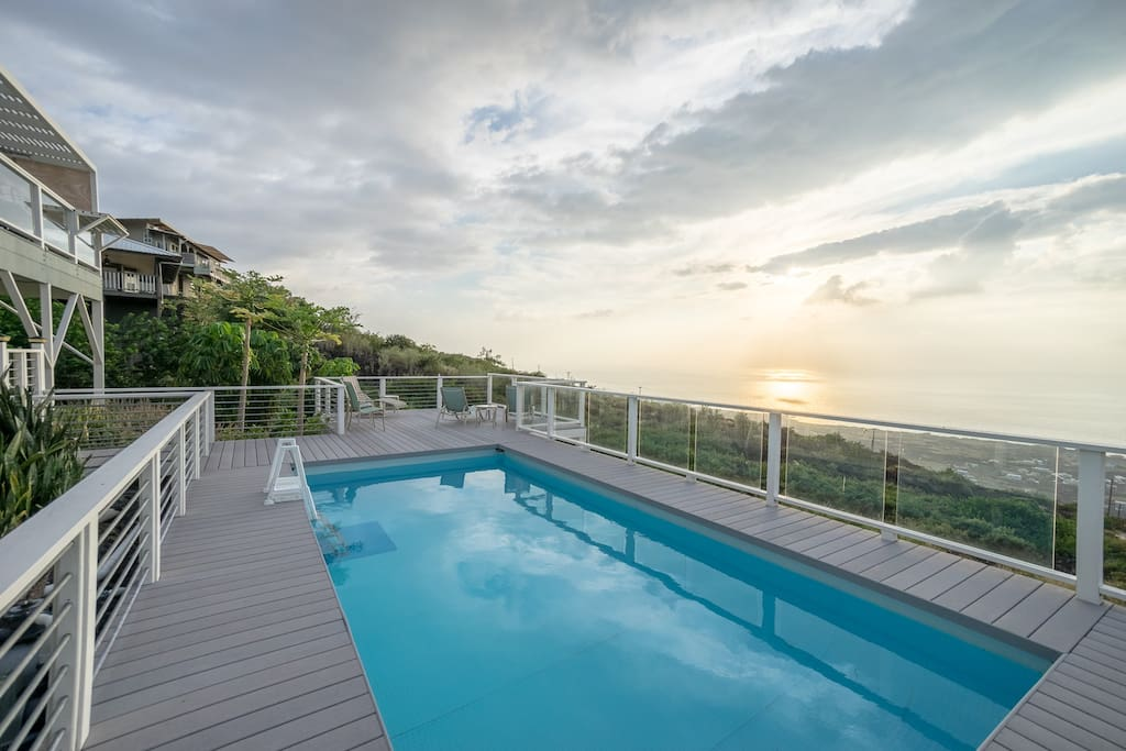Fenced pool with ocean view