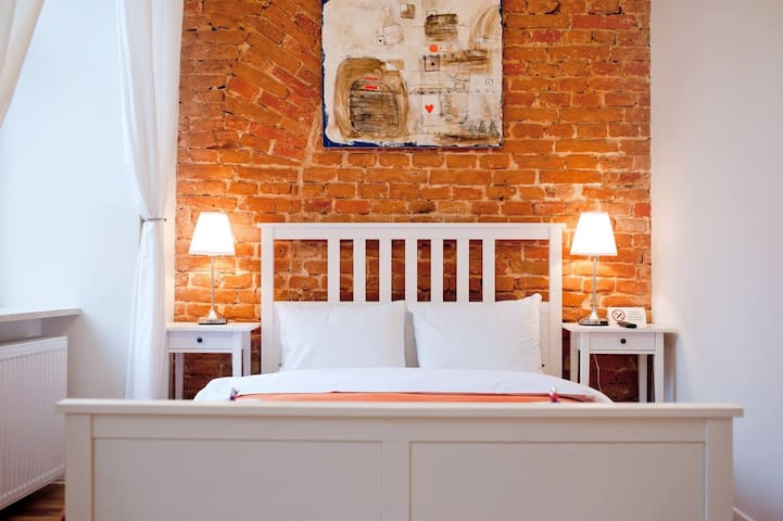 Original art and exposed brick in every room