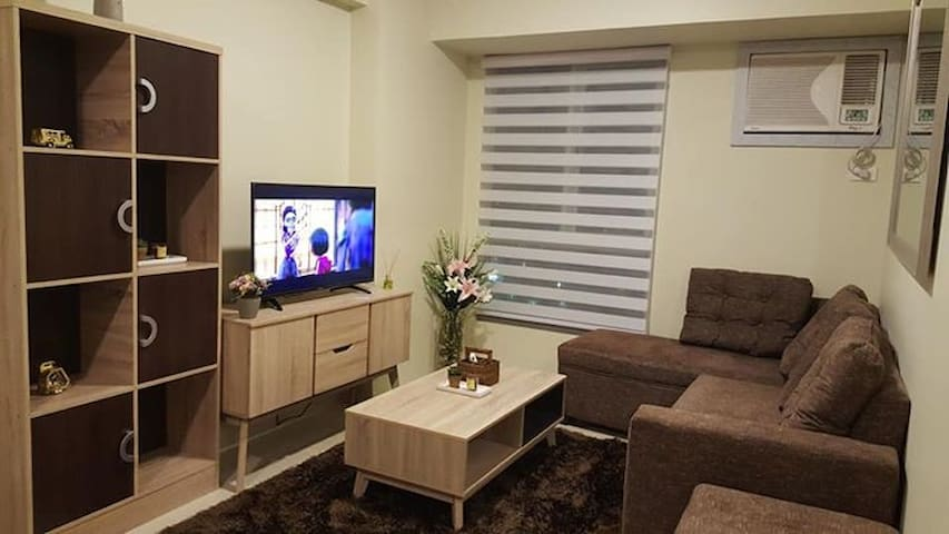 CLAIM YOUR COSY SANCTUARY IN THE HEART OF BGC!