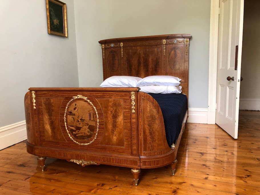 Blue Room with antique English satinwood queen sized bed