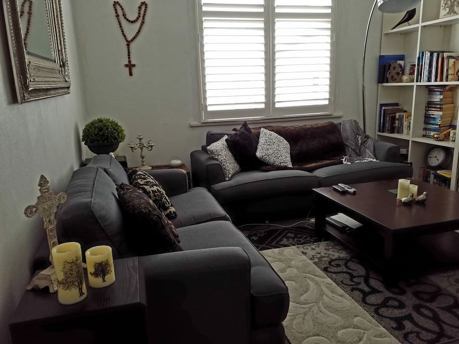 Comfy couches with large t.v. sky, for airbnb guests only.