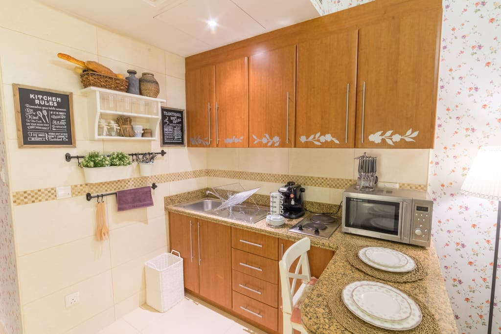 Fully Equipped Kitchen Including Microwave, Coffee Machine, full-set of cutleries.
